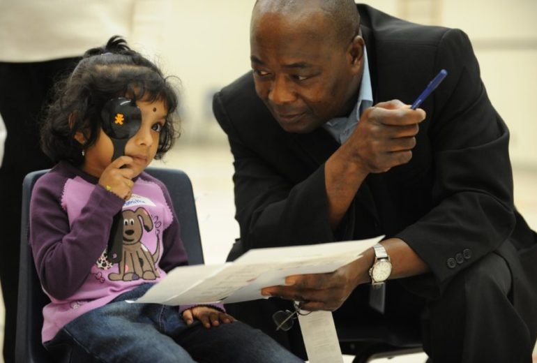 Sept 30 2008 pics of asmitha balakumar,4 gets her eyes tested by optician akwasi donkor boakye schoo